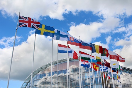 EU flags with clouds.jpg